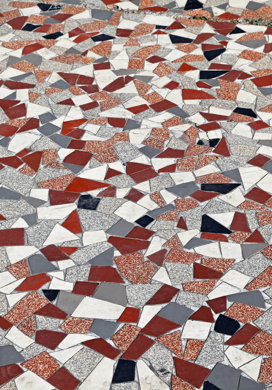 Terrazzo was created over 500 years ago when mid-16th century artisans began wondering what to do with odd-sized marble chips discarded during construction projects. Lovely to look at, but essentially leftovers, an inspired idea was born. Why not used the marble remnants to build terraces that would bring added luxury to their own working-class homes?